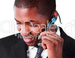 Close-up of an businessman using an bluetooth earpiece