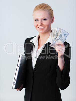 woman holding dollars and a laptop