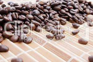 Coffee beans on bamboo placemat