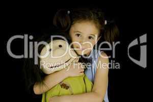 sweet little girl embraces her favorite doll