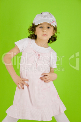 little girl with peaked cap and summer dress