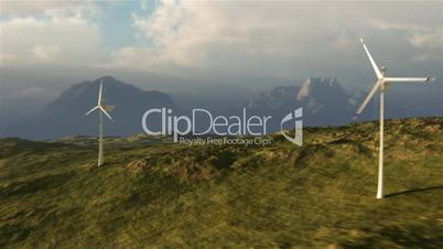 (1114) Wind Turbine Power on Plains with Stormy Weather Clouds and Mountain Sunset