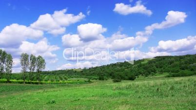 green hill and blue sky. time lapse HD