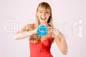 young blond woman offers a cd