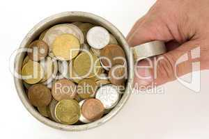 Old aluminum mug and coins.