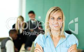 Businesswoman in front of people working in an office
