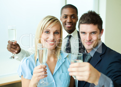 Happy businessteam with champagne in office