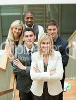 Businesspeople with a woman in the middle