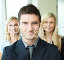 Portrait of a businessman with two businesswomen
