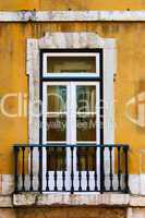 window in old yellow wall