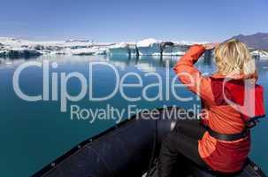 Woman Explorer Using Boat in Iceberg Field, Jokulsarlon Lagoon,
