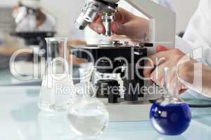 Scientist Using Microscope in a Medical Research Laboratory