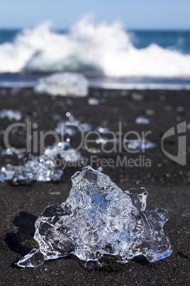 Icebergs Breaking On Black Sand Beach In Iceland