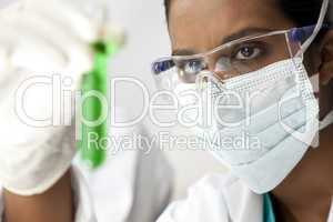 Asian Female Scientist or Doctor With Green Solution In Laborato