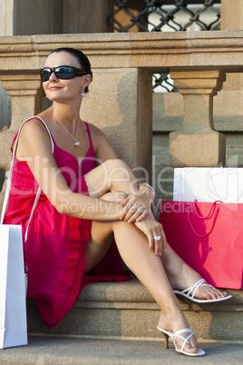 Beautiful Young Latina Woman Relaxing With Shopping Bags