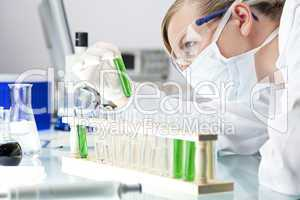 Female Scientist or Doctor With Green Solution In Laboratory