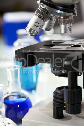Microscope in a Scientific Research Laboratory With Flasks