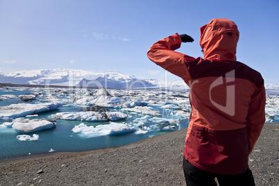 Female Hiker Looking at Iceberg Filled Lagoon, Jokulsarlon, Icel