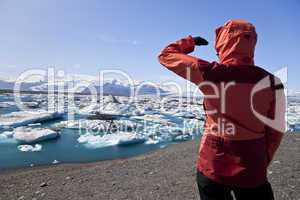 Female Hiker Looking at Iceberg Filled Lagoon, Jokulsarlon, Icel