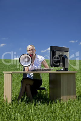 Woman Using Megaphone In A Green Field