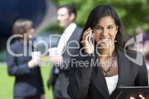 Asian Businesswoman On Her Cell Phone