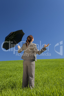 Woman In A Green Field With Umbrella
