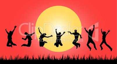 personen springen vor sonnenuntergang
