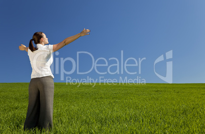 Young Woman Celebrating In A Green Field