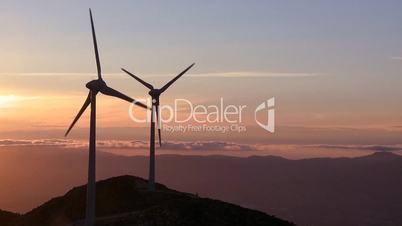 Wind turbine generator at sunset