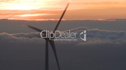Wind turbine in the mountains at sunset
