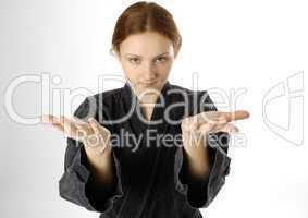 Girl in uniform of martial art on light background