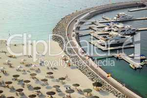 Yacht parking near luxury hotel and beach, Dubai, UAE
