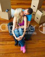 Couple moving to new house and kissing each other