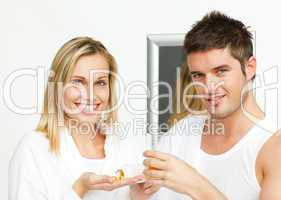 couple in bathroom with pills