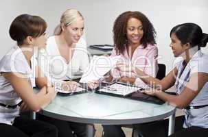 Businesswomen In Office Meeting