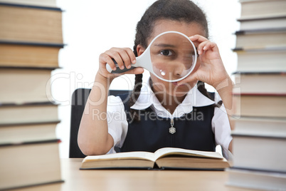 Young School Girl Reading A Book