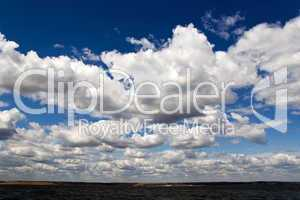 Seashore and cloudy sky