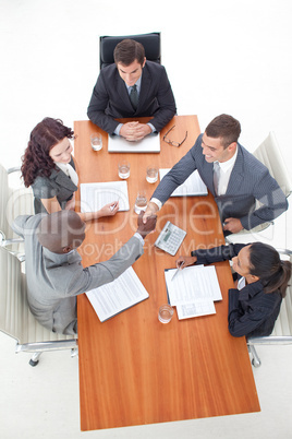 shaking hands in a meeting