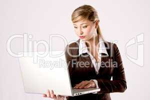 business woman is using a laptop