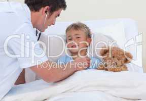 Doctor listening to a child breaht with stethoscope