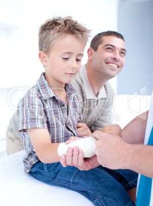 Bandaging an arm injury on a child