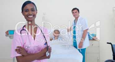 Smiling Indian nurse with doctor and patient