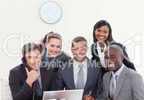 Group of people smiling in a business meeting