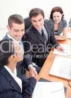 Business team in a meeting shaking hands