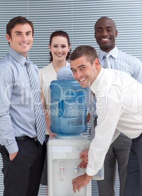 Busines people standing around water cooler