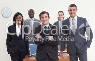Confident business team standing in a meeting and smiling