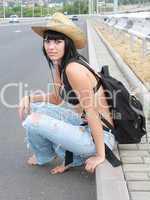 girl in yellow hat near roads