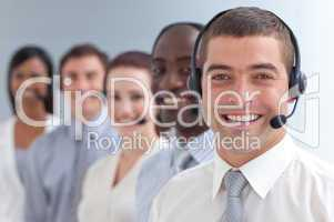 Smiling businessman standing  in a call center in a line