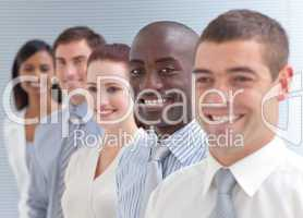 Business team in a line. Focus on an Afro-American man