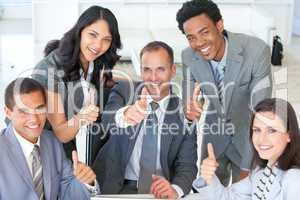 Business team with thumbs up in office